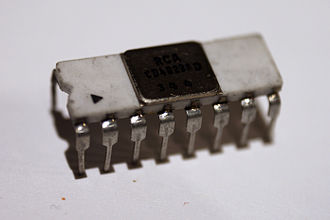4000-series integrated circuits - A very early CD4029A counter IC, in 16-pin ceramic dual in-line package (DIP-16), manufactured by RCA