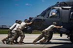 41st Helicopter Maintenance Unit push an HH-60G Pave Hawk.jpg