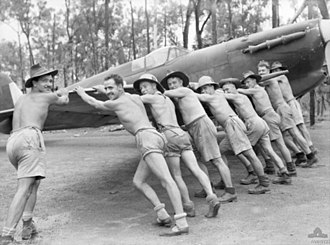 No. 457 Squadron RAAF - No. 457 Squadron ground crew push a Spitfire into its dispersal bay at Livingstone Airfield during February 1943