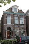 foto van Herenhuis in een eclectische stijl met Art Nouveau-versieringen
