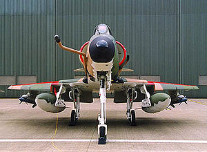 ST Aerospace A-4SU Super Skyhawk - Head on profile of an A-4SU Super Skyhawk, note the cranked refueling probe, the drooped leading edge slats as well as the ram-air intake. Also, inert AIM-9 Sidewinders painted in blue are carried on the outboard pylons.