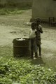 ASC Leiden - F. van der Kraaij Collection - 01 - 019 - Two children outdoors near a barrel of garbage - Monrovia, Montserrado County, Liberia, 1976.tiff