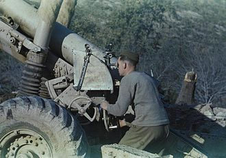 BL 5.5-inch Medium Gun - A British gunner uses the dial sight and range scale plate of a 5.5-inch Gun in 1944.
