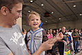 A boy smiles for the camera as family and friends wait for the arrival of U.S. Airmen returning from a deployment at Cannon Air Force Base, N.M., Aug. 7, 2011 110807-F-AX764-029.jpg
