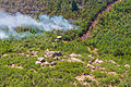 A bulldozer creates a firebreak to help fight the East Peak wildfire near La Veta, Colo., June 21, 2013 130621-Z-UA373-248.jpg