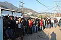A large number of voters in a queue to cast their vote at a polling booth of the Agri Electrical Colony Kalinba town, during the Nagaland Assembly Election, at Kohima on February 23, 2013.jpg