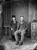 A man with a young girl NLW3364886.jpg