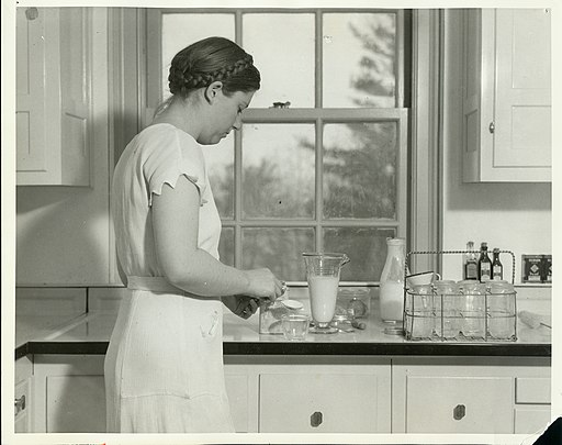 A student 'mother-of-that-week' living in one of the homemaking apartments prepares the day's food - (3857207084)