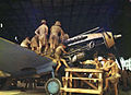 Airmen in tropical dress work on the engine of a Tomahawk.jpg