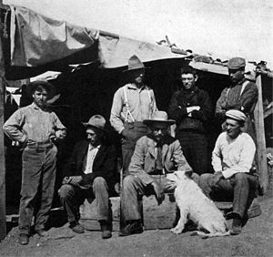 Walter W. Granger - American Museum party at Bone Cabin Quarry, Wyoming, 1899. Seated, left to right: Walter Granger, Professor H.F. Osborn (with 'Jack'), Dr. W.D. Matthew; standing, F. Schneider, Prof. R.S. Lull, Albert Thomson, Peter Kaisen.