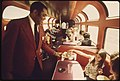 An-amtrak-passenger-service-director-serves-cookies-to-passengers-in-the-lounge-car-of-the-southwest-limited-enroute-from-albuquerque-new-mexico-to-dodge-city-kansas-june-1974 7158197948 o.jpg