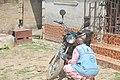 An Okada man tending to his ride.jpg