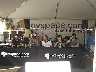 Warped Tour - Anberlin preparing for a meet-and-greet at the MySpace tent on the 2007 tour. Performers often meet with fans and sign autographs at the various artist and sponsor tents.