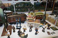 Antique toy railroad scene (27068529761).jpg