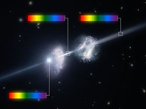 Artist's impression of a gamma-ray burst shining through two young galaxies in the early Universe.jpg