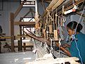Assamese woman using traditional handloom.jpg