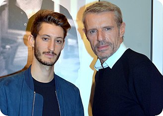 The Odyssey (film) - Lead actors Pierre Niney and Lambert Wilson at a premiere in October 2016.