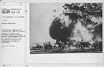 "Balloons - Accidents & Wrecks - Balloon Explosion. Kite Balloon inflated with hydrogen gas ignited by static caused by soldiers hair brushing against balloon . A special non-inflammable ""Helium"" gas now being tri(...) - NARA - 20807632.jpg"