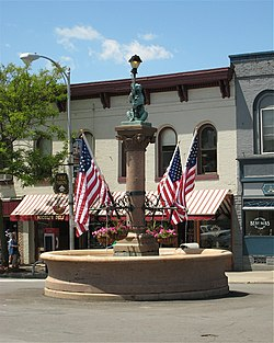 The Bear Fountain sits in the center of Geneseo's Main Street. In this picture, it is decorated with flags for Memorial Day.
