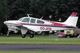 Belgian aircraft registration and serials - Image: Beech.bonanza.takeof f.arp