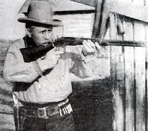 Battle of Cimarron - Bill Tilghman posing with his Winchester rifle.