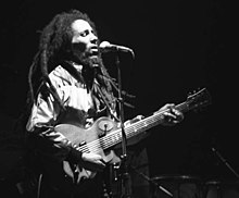 Bob Marley singing and playing guitar at a concert in Zurich, Switzerland in 1980.