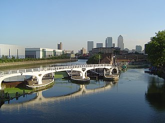 Bow Creek (London) - Bow Creek (tidal) (far left) meets the Limehouse Cut (canal, right), at Bow Locks on the Lee Navigation (centre); with a view of London's Docklands