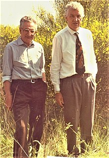 Two middle-aged men stood in scrubland