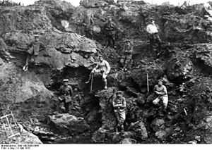Fromelles - German soldiers posing on a crater left by the explosion of a mine. The photo is dated 9 May 1915, the start of the Battle of Aubers Ridge.