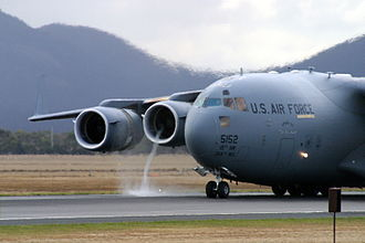 Thrust reversal - A vortex made visible as powerback is used on a Boeing C-17 Globemaster III