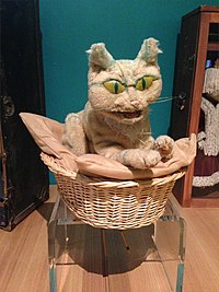 Hand puppet of a cat sitting in a basket