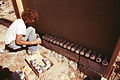 CONSTRUCTION OF ONE OF THREE EXPERIMENTAL HOUSES BUILT FROM EMPTY BEER AND SOFT DRINK CANS - NARA - 556637.jpg