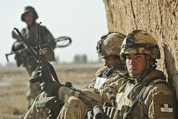 Canadian and Afghan National Army soldiers patrol in Badula Qulp during Operation Moshtarak.jpg