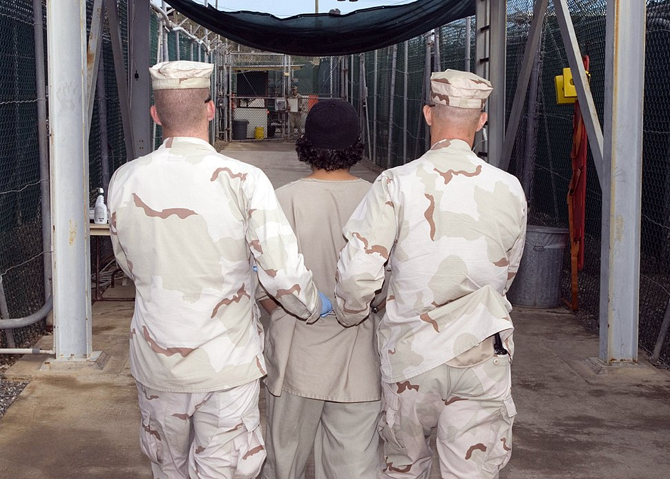 Captive being escorted for medical care, December 2007