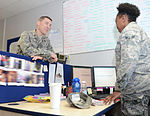 Chaplain builds bridges with smiles by children in need 150203-F-FE537-015.jpg