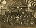 Chaplain presiding over religious service with soldiers at Camp Raritan, circa 1920 (4863356311).jpg