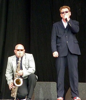 Lee Thompson (saxophonist) - Image: Chas Smash and Lee Thompson on stage 2009 (cropped)
