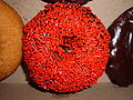 Chocolate-covered doughnut with red sprinkles.JPG