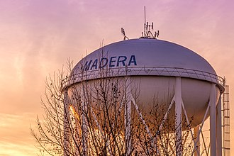 Madera, California - Photograph of City of Madera Water Tower taken during a Fall sunset.