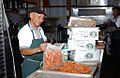 Contract worker prepares a big pot of food at Guantanamo -b.jpg