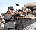 Corporal Onni Ryyppö of the 44th Border Jäger Company, posing with his sniper rifle for the cameraman in the frontlines at Valkeasaari (Beloostrov), Karelian isthmus, 15 April 1942. (50258242472).jpg