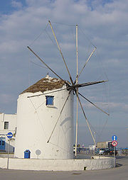 A fixed windmill typical of the Cyclades Islands