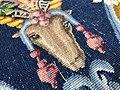 Détail de l'envers d'un tapis de Savonnerie (tête d'animal).jpg