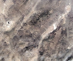 Geology of the Death Valley area - The Death and Panamint valleys area from space. The elliptical depression to the left is the Searles Lake basin, the smaller linear valley is Panamint Valley and the larger one is Death Valley. The mountain range between Death and Panamint valleys is the Panamint Range and the Black Mountains bound the other side of Death Valley. (NASA image)