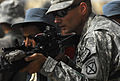 Defense.gov News Photo 100828-N-6538W-084 - U.S. Army Sgt. James Henderson right of the 1st Battalion 87th Infantry Regiment 10th Mountain Division assists an Afghan National Police officer.jpg