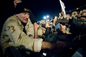 Camp Arifjan - Comedian Robin Williams signs autographs at Camp Arifjan, Kuwait, Dec. 17, 2007, during the second stop of the 2007 USO Holiday Tour.