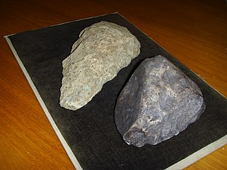 "Oldowan - Stone tool (Oldowan style) from Dmanisi paleontological site (right, 1.8 mya, replica), to be compared with the more ""modern"" Acheulean style (left)"
