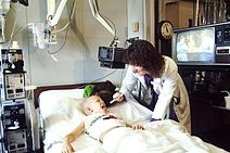 Doctor examines pediatric patient.jpg