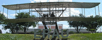 The Wright Flyer statue is the centerpiece of the Daytona Beach campus. The Jack. R. Hunt Memorial Library is visible in the background.