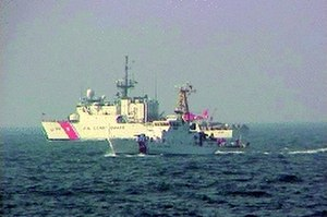 EgyptAir Flight 990 - The U.S. Coast Guard cutters USCGC ''Monomoy'' (WPB-1326) (foreground) and USCGC ''Spencer'' (WMEC-905) searching for survivors of the crash